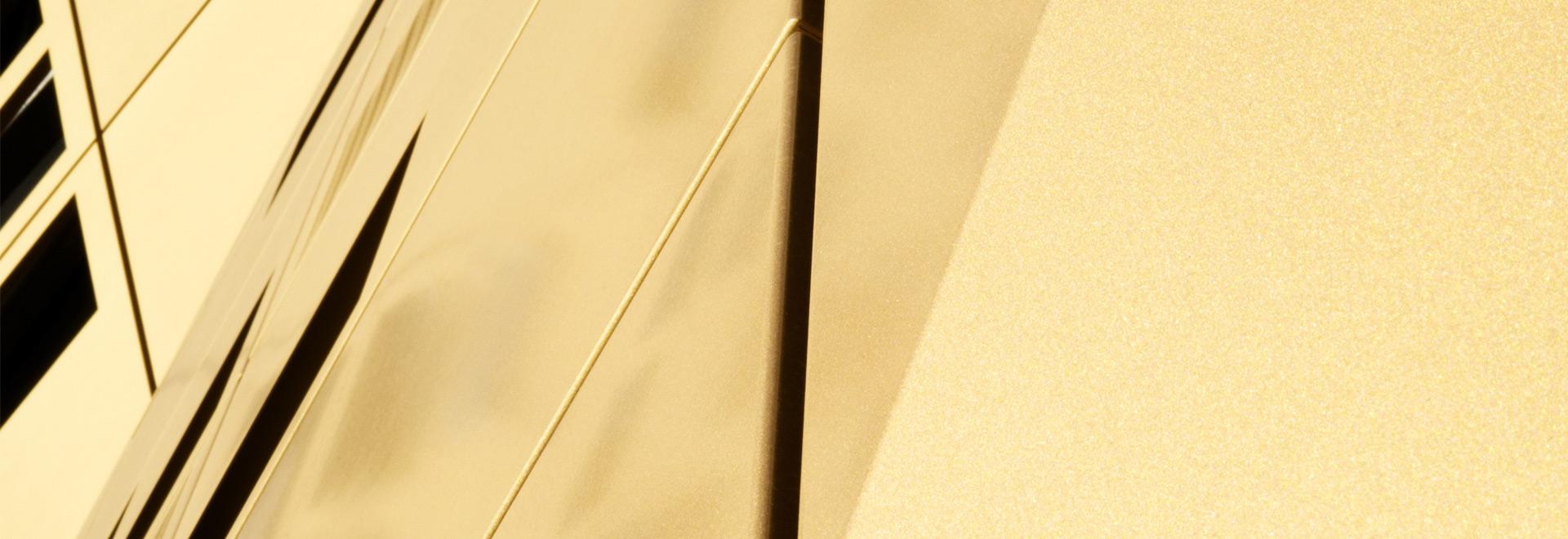Detailaufnahme einer goldenen Duraflon-Oberfläche
